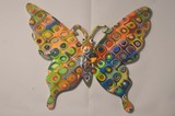 Papillon en résine motif ronds