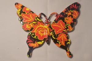 Papillon en résine motif noir/orange
