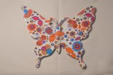 Papillon en résine motif flower power